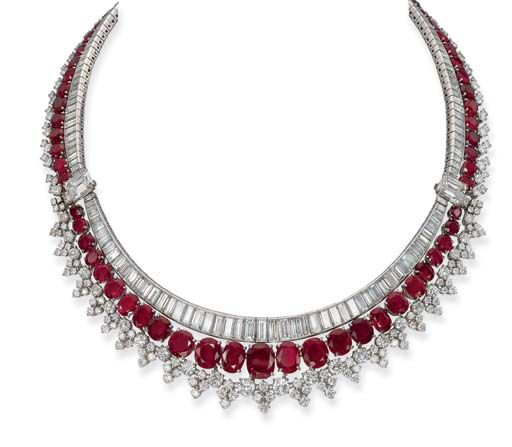 AN ATTRACTIVE RUBY AND DIAMOND NECKLACE, BY HARRY WINSTON   Designed as a graduated baguette-cut diamond row set with two rectangular-shaped diamond side clasps to the oval-shaped and circular-cut ruby fringe with brilliant-cut diamond border, detaching to form two separate necklaces, circa 1955, 37.0 cm long, in black suede pouch  Unsigned