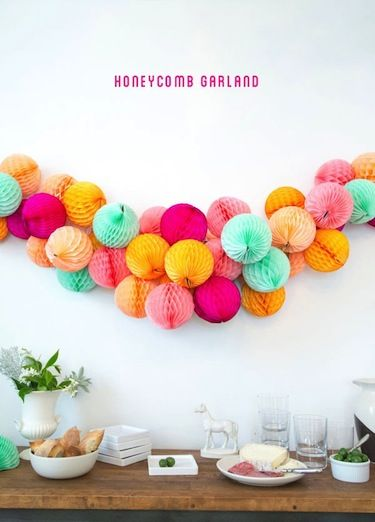 This honeycomb garland, courtesy of Oh Happy Day, is absolutely stunning!  This looks beautiful hanging but I could also imagine it as a table runner maybe with lights strung along with it for a bit of sparkle.