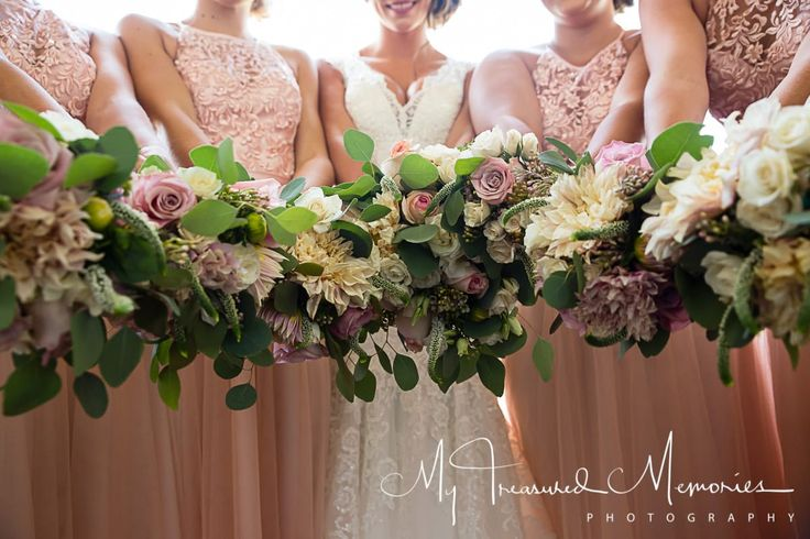 Gorgeous bride + bridesmaid bouquets for a blush pink wedding!  Taken at THE SPRINGS in New Braunfels.