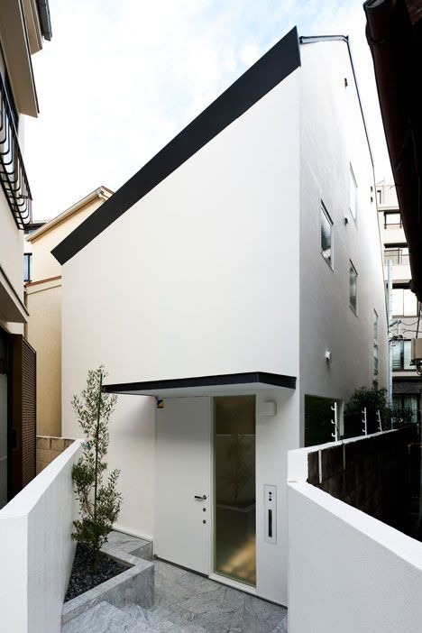 "I love how this is surrounded by more typical housing.  Tokyo house by Atelier Tekuto with skylight designed to ""frame the sky"""