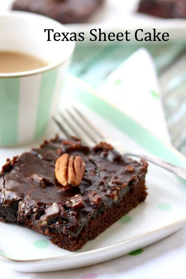This classic Texas Sheet Cake recipegives you a dense, thin chocolate cake that\'s almost like a brownie. It\'s an heirloom recipe  made with buttermilk, cocoa and plenty of pecans so that the icing is like fudge candy!  from RestlessChipotle.com #TexasSheetCake #chocolatecake