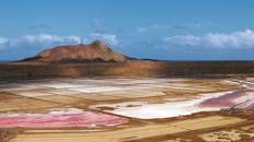 """""""Inside a ring of mountains lies the Pedra de Lume, a sweeping geometry of saltpans in blue, pink and green depending on their stage of salt formation."""" Cape Verde: the Bradt Guide; www.bradtguides.com"""