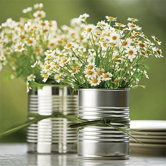 Love this use of cans for table pieces! Need better flowers though. :)