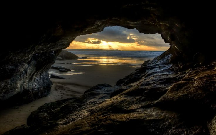 A great shot showing winter on the beach, taken from inside a cave on Watergate Bay looking towards Newquay