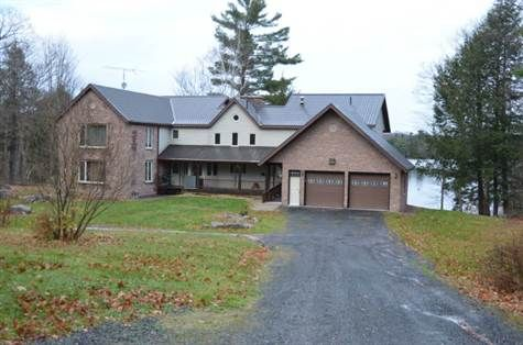 Beautiful contemporary designed 4 seasons home (or cottage or family compound) on 1.57 acre gently slopping  nicely treed lot fronting 200` on Little Whitefish (Clear) Lake with child friendly sandy beach. 6,175 sf of living space, 5 bedrooms, 4.5 bathrooms, family, living, games, rec, large office and hot tub rooms. Property taxes are $6,300. Asking price $1,149,000 negotiable ... http://www.real-estate-ontario.ca/Listing/ViewListingDetails.aspx?ListingID=95166209…