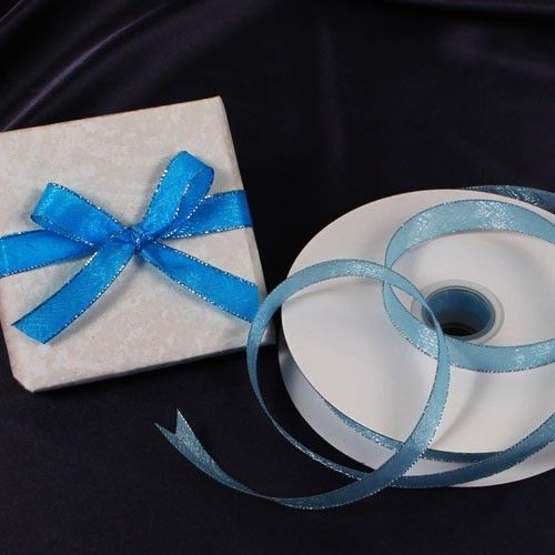 """If you're looking to personalize a ribbon, wrap a gift, or tie an almond sachet, look no further than Ruby Blanc's """"Satin & Silver"""" ribbons. The vibrant pop of aqua and stunning silver trim make this ribbon perfect for any occasion.  #ribbon #partysupplies #ribbons #gifts #giftwrapping #crafting #crafts #rubyblanc"""