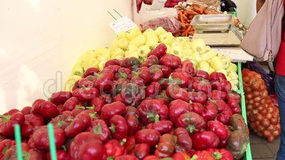 Red and yellow Bell peppers at market.