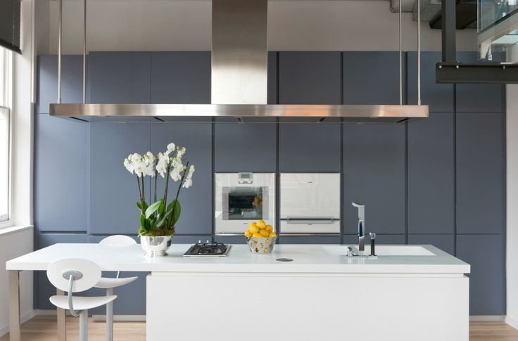 The sleek kitchen, featuring the Corian island unit and