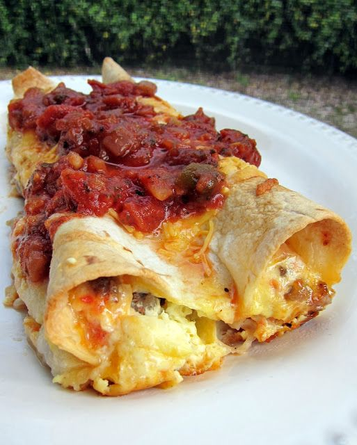 Southwestern Quichiladas ~ sausage and Rotel tomatoes, this is so good.   The dish is assembled the night before and baked the next morning.