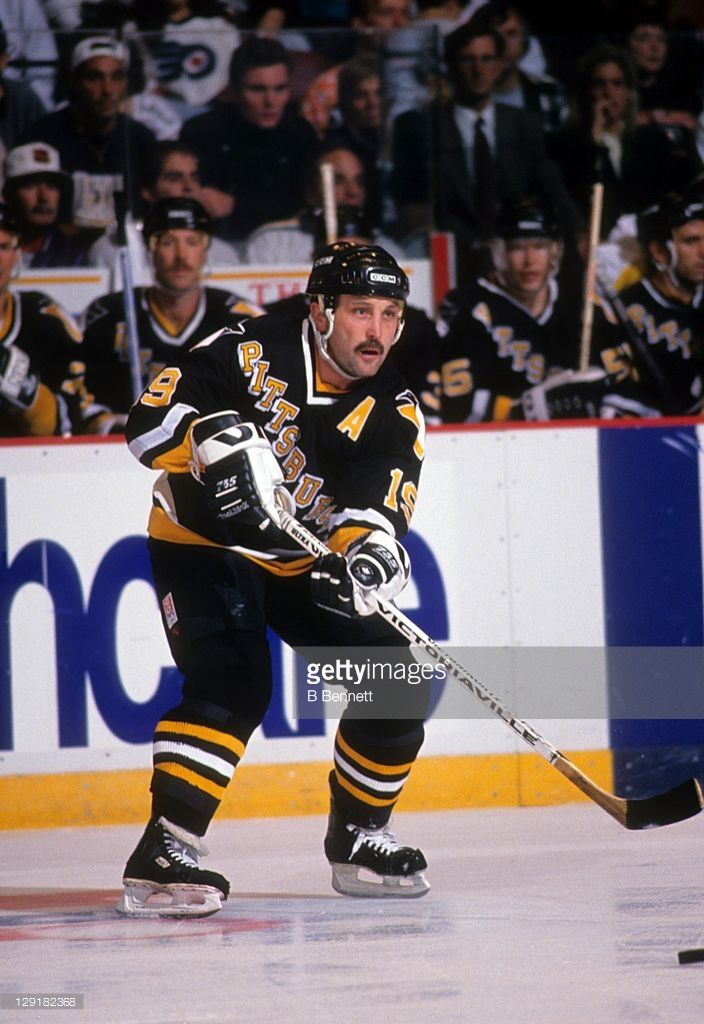 Bryan Trottier #19 of the Pittsburgh Penguins passes the puck during an NHL game against the Philadelphia Flyers circa 1993 at the Spectrum in Philadelphia, Pennsylvania.