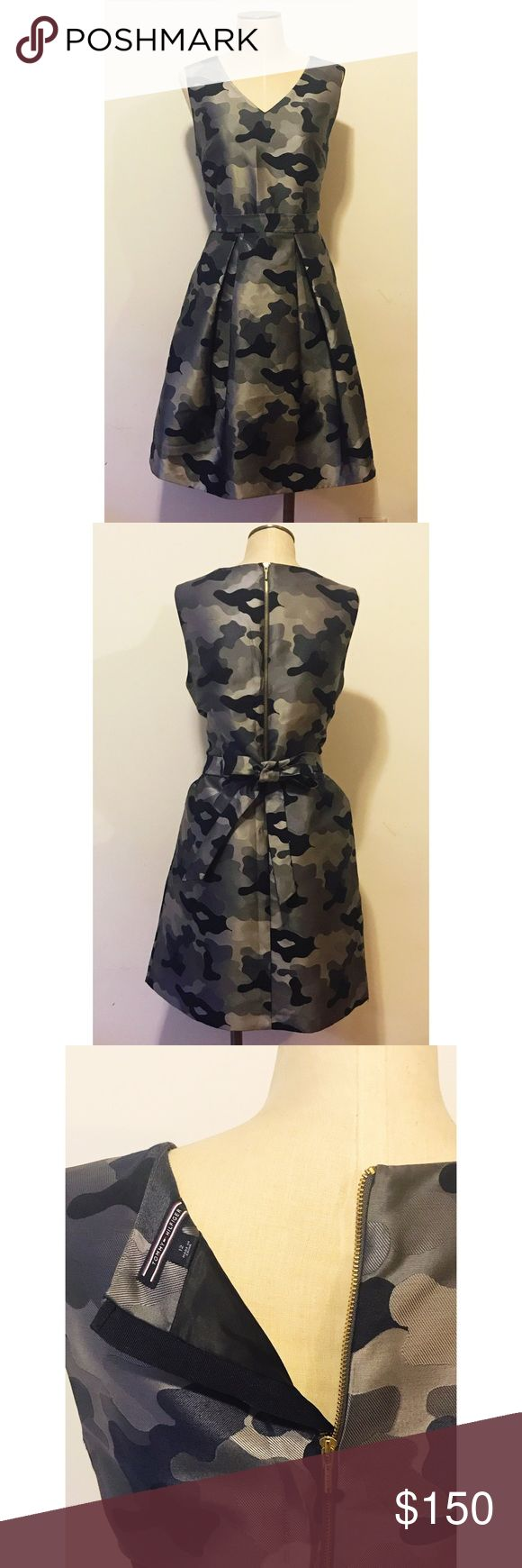 "Camouflage aline cocktail dress Sleeveless camouflage aline dress, amazing material and very flattering fit, ideal for weddings, galas, graduations or any semi formal event, can be worn with tights in winter or bare for warmer events, comes with ""belt"" in matching material, belt can be worn with bow in front or back Tommy Hilfiger Dresses"