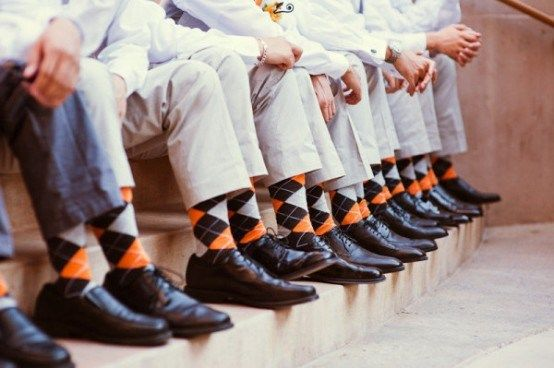 Matching Fun Socks - Choose a pair of fun socks for the groomsmen to sport in (mostly) secret. Then surprise everyone with a revealing picture like this!..this would be double cute if we got a whole bunch of miss-matched socks. Everyone makes fun of the both of us for doing that. It would be a cute addition.
