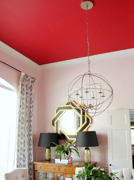 Paint your ceiling an unexpected color like red paint color Show Stopper (SW 7588).