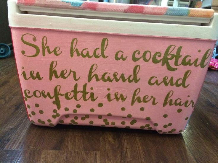 She had a cocktail in her hand and confetti in her hair / Pink and gold girlie cooler--maybe as initiation basket