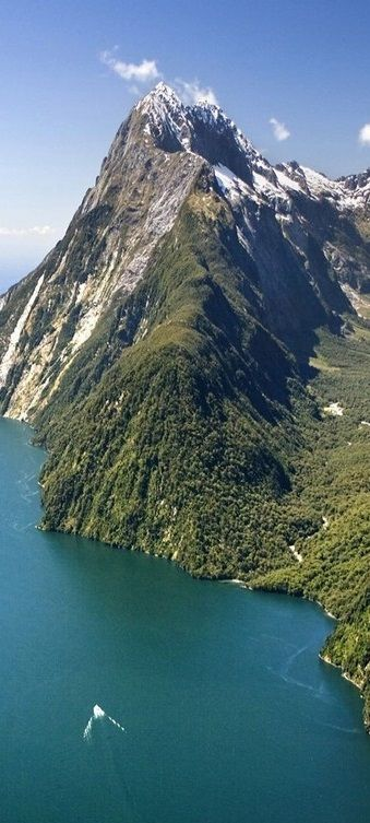 An aerial view of Milford Sound and Mitre Peak located within Fiordland National Park, Piopiotahi Marine Reserve and Te Wahipounamu - NZ