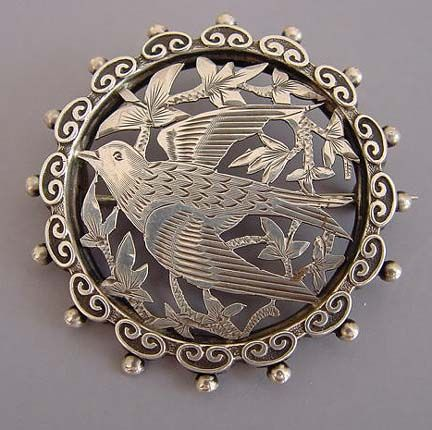 VICTORIAN silver round pierced and etched bird design brooch with beaded edge