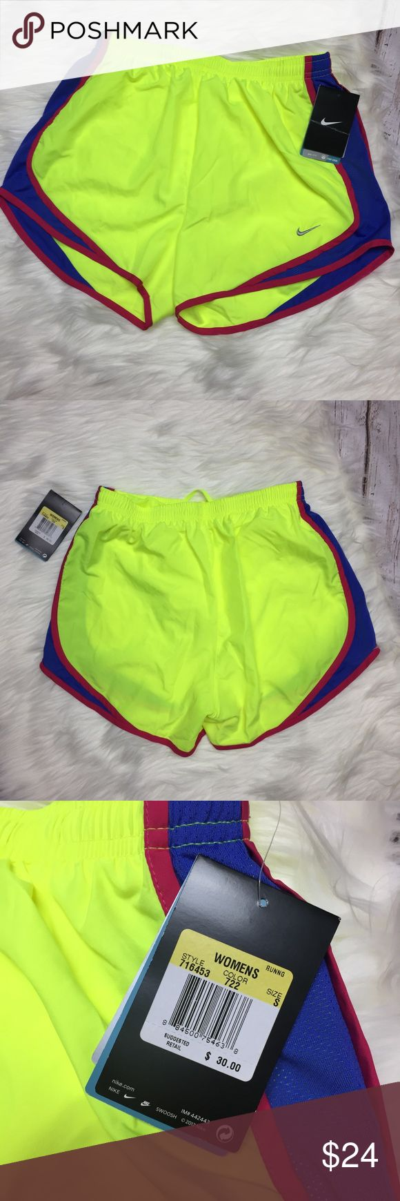 Dri-Fit Nike neon shorts NWT Dri-Fit Nike neon yellow/green shorts. Blue and red side details. NWT. Size small. ✨ no trades, please. Nike Shorts