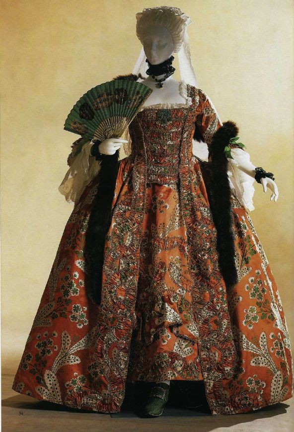 (Pinned for the trimming design) Robe a la francaise, about 1760th Bright orange Lyon brocade with a pattern and trim, pagoda sleeves with double flounces, ruffles white linen. Hair ornament lappet of Brabant lace. France.  (From KCI collection?)