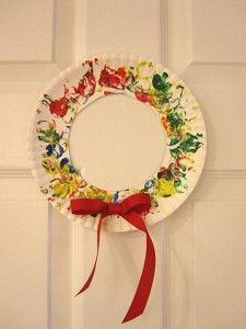 cork painted paper plate christmas wreath!  Love it for a toddler activity.