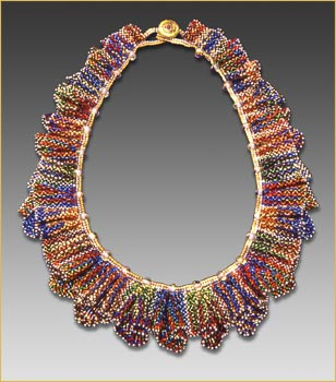 Love the ruffles on this beaded necklace!