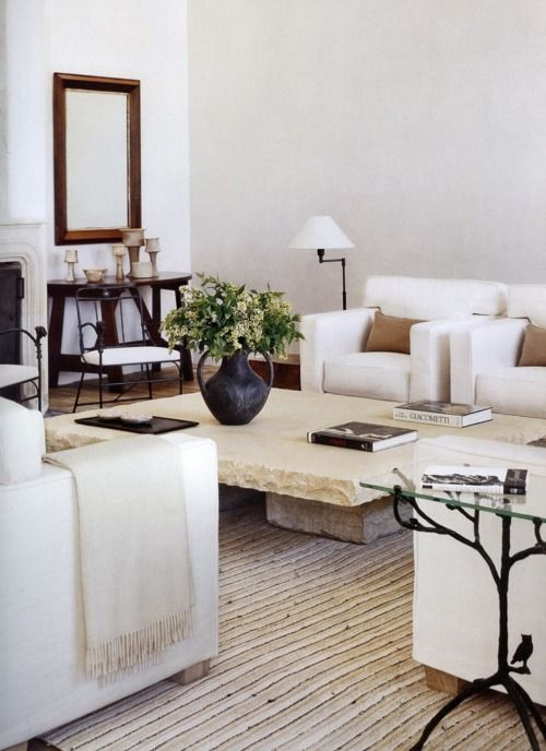 Clean lines, fresh, neutral living room. Love this stone table