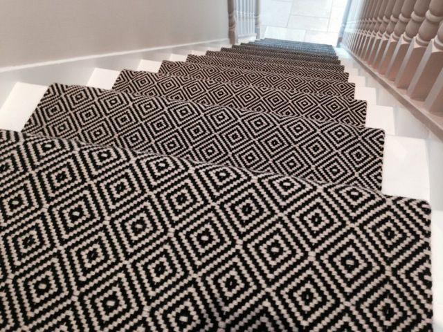 Diamond Black & White stair runner. Our 100% wool flatweave runner looks striking against the white stairs.