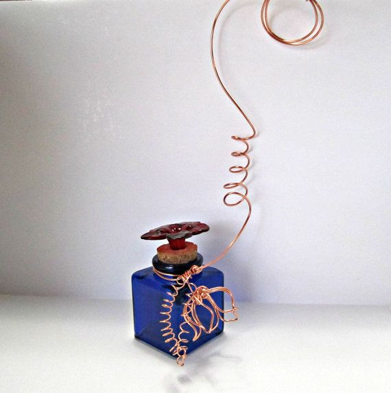 Use coupon code: PIN10 for 10% off! This glass #hummingbird #feeder is made of one cobalt blue square jar accented with brass, copper or nickel wire. First you choose your bottle, then choose the wire and your ... #decorative