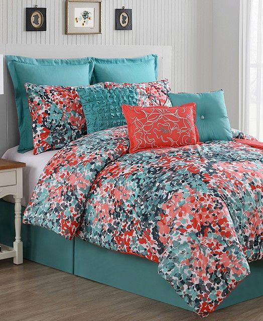 Bring a vibrant look to your room with the Capri Comforter Set, featuring a comforter and shams with a watercolor-inspired print in bright coral and aqua tones on a white ground and brilliant decorati