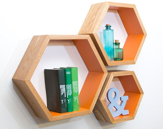 Listing Information ------------------------------ Hexagons are the bees knees, and this set of honeycomb shelves is the perfect way to spruce up your decor! You can leave them empty as an art piece, or display your favorite trinkets, pictures, candles and plants! This listing is for a set of three hexagon shelves. Each shelf measures approximately 10 tall x 11.5 wide x 4.5 deep and hangs individually. ------------------------------ Pictures ------------------------------ 1.) Walnut…