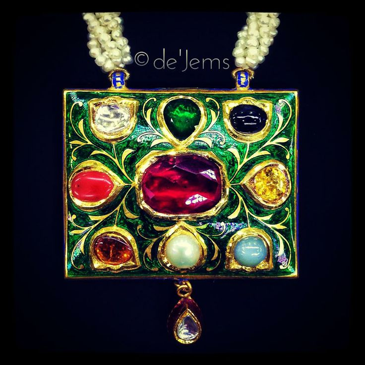 Jadau pendant, ft. 13.10ct of the nine sacred gemstones: Ruby, Emerald, Blue Sapphire, Yellow Sapphire, Cat's Eye, Pearl, Hessonite, Coral and Diamond. For Rs.1,17,000/- only.
