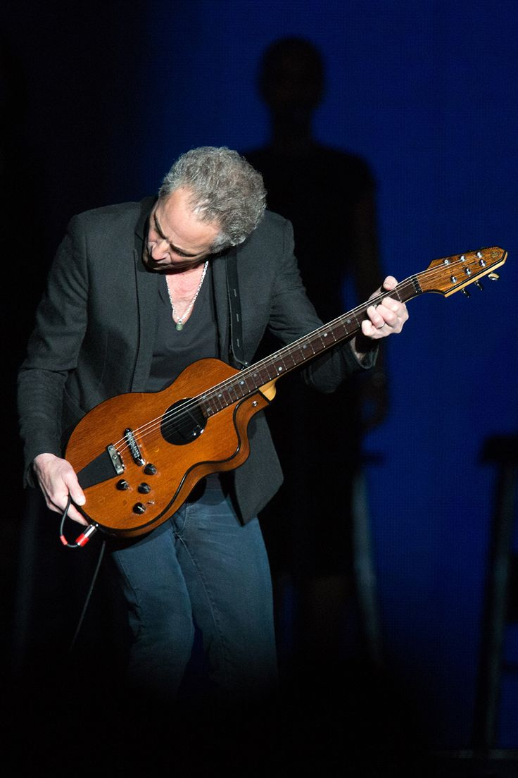 Lindsey Buckingham-this man plays his fingers off in concert! An unbelievable talent, mesmerizing to watch him perform a long guitar solo.   He gets so into his music!