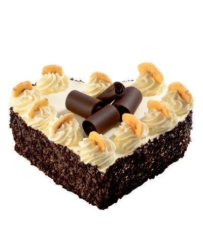Dortové srdce Banánové Svěží kombinace banánů a čokolády na čokoládovém korpusu s krémem ze zakysané smetany. Ozdoben čokoládovými hoblinkami.