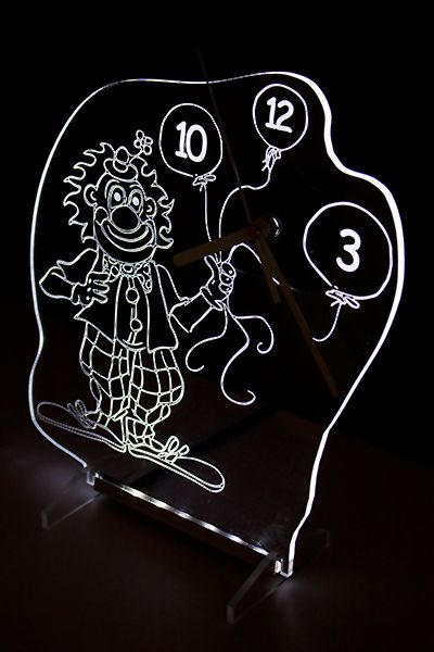 Clock with white backlight LED in the shape of a clown. New design.