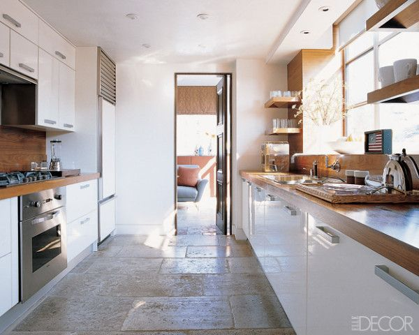 Room/Style: Kitchen, Contemporary    Notes: In the kitchen of a New York City duplex decorated by Tom Fox and Joe Nahem of Fox-Nahem Design, the oven and cooktop are by Viking, and the refrigerator is by Sub-Zero; Fox-Nahem designed the walnut counters and open shelving.    Photographer: Pieter Estersohn  Designer: Tom Fox and Joe Nahem  Homeowner: Luigi Caiola and Sean McGill  Issue: February 2004
