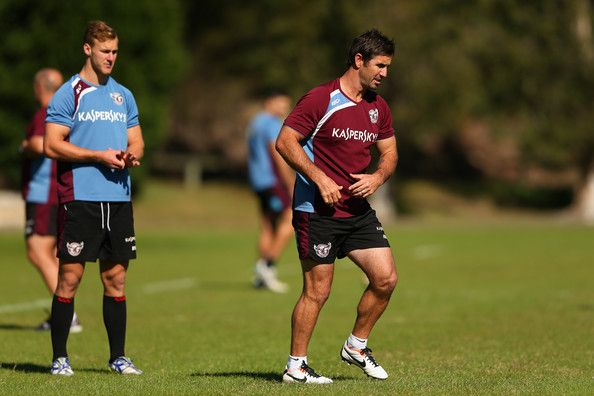Andrew Johns coaches Daly Cherry-Evans of the Sea Eagles during a Manly Sea Eagles NRL training session at the Sydney Academy of Sport on May 17, 2013 in Sydney, Australia.