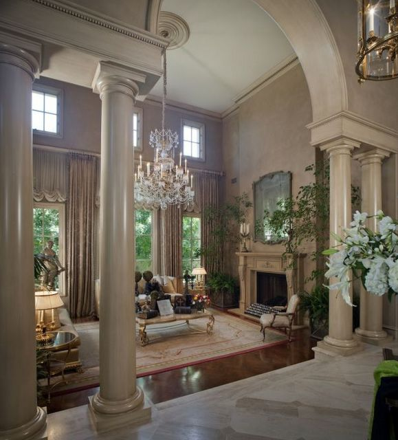 Beautiful living room.....love the columns!!