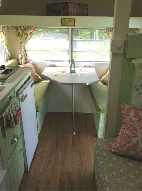 A tiny little vintage shabby chic camper.