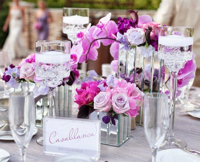 Love this modern and simple centerpiece.  Great way to tie in your wedding colours