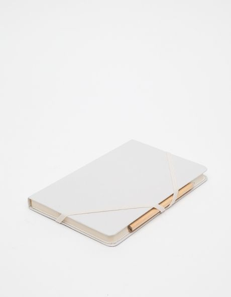 Makr Sketchbook - all white sketchbook with two elastic bands that hold a pencil or pen