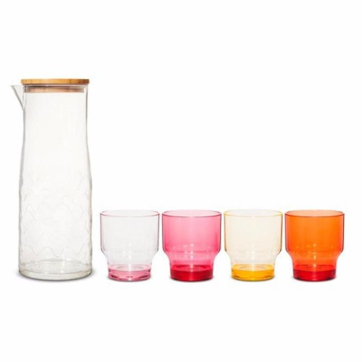 Of all the items offered by Marimekko for Target I think this Carafe Drinkware Set is one of the most useful and classic designs. Glasses stack inside the pitcher for storage, each color adding an elegant vibe to a picnic or patio! 5pc Lokki Print Warm Color Pink Orange New