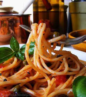 Spaghetti alla Puttanesca - this is a super tasty but easy recipe by Elizabeth's Kitchen Diaries.