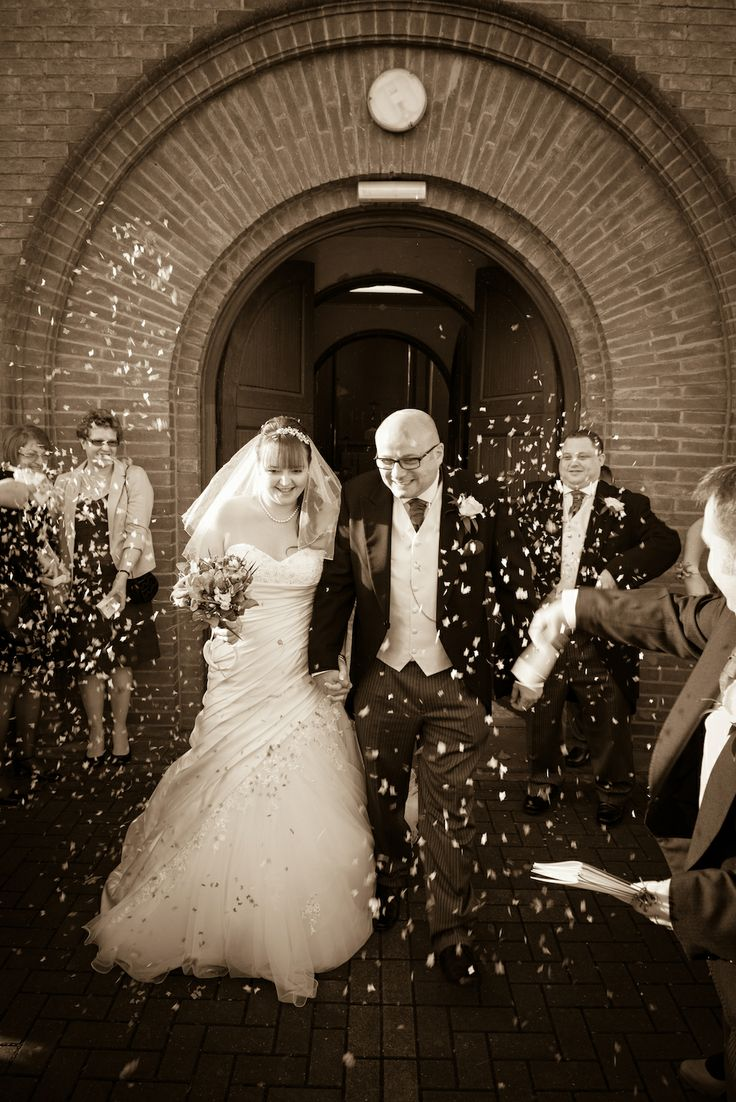 leaving the church under confetti