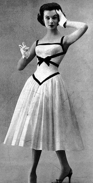 Love that Disney Princess waist. Leonie Vernet, Vogue, April 15, 1956