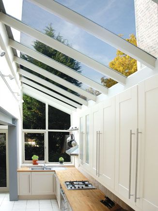 This kitchen side extension makes great use of VELUX roof windows to let in plenty of daylight and create a spacious feel. Via www.buildteam.com
