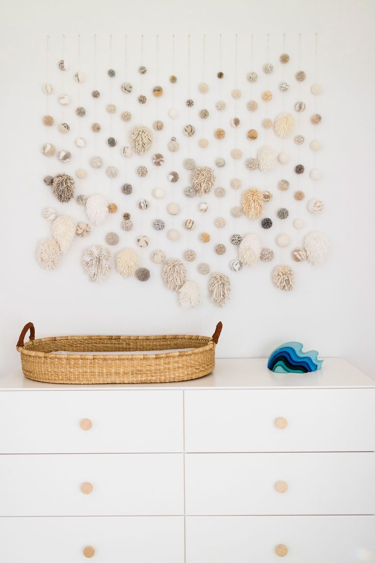 Gorgeous pom pom wall for baby's nursery - Wellroundedny.com