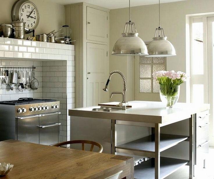 edelstahl küche insel mit holz tisch rattan stuhl weiß