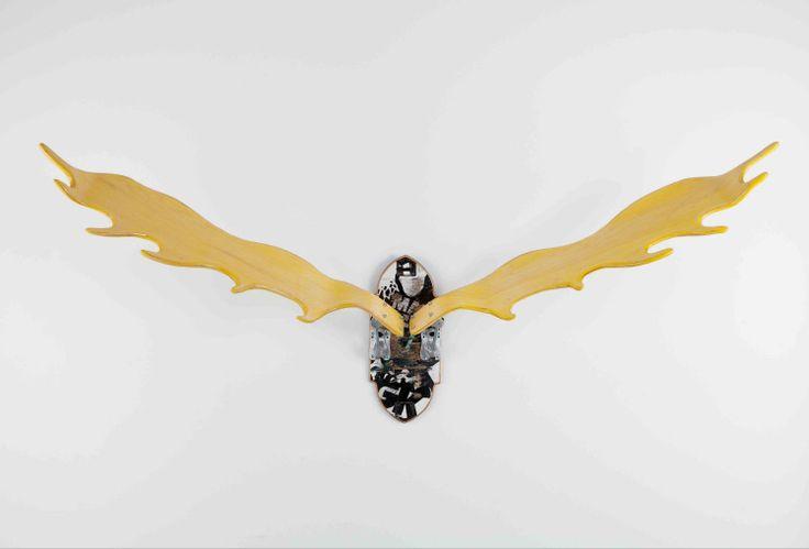 Joshua Van Dyke's work is currently on view at Provide. He uses skateboard decks to create antler and wildlife trophies.: Dyke Work, Joshua Vans, Skateboard Decks, Vans Dyke, Yellow Antlers, View, Create Antlers, Recycled Skateboard