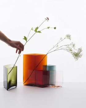RuutuRuutu, which means diamond or square in Finnish, is a collection of 10 vases available in five sizes and seven colours. When collected and combined, they make small seamless installations where both the strength and the delicate nature of the glass come alive.  115 x 80 mm Clear, desert 115 x 140 mm Cranberry, salmon pink 115 x 180 mm Clear, Grey 205 x 180 mm Moss green, cranberry 205 x 270 mm Clear, copper