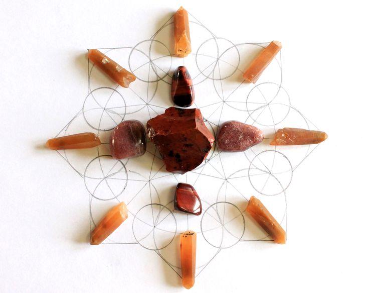 Mandala  de energía roja, acivando el primer chakra... puntas de cuarzo hematoideo, aventurina roja, ojos de buey y obsidiana mahogani