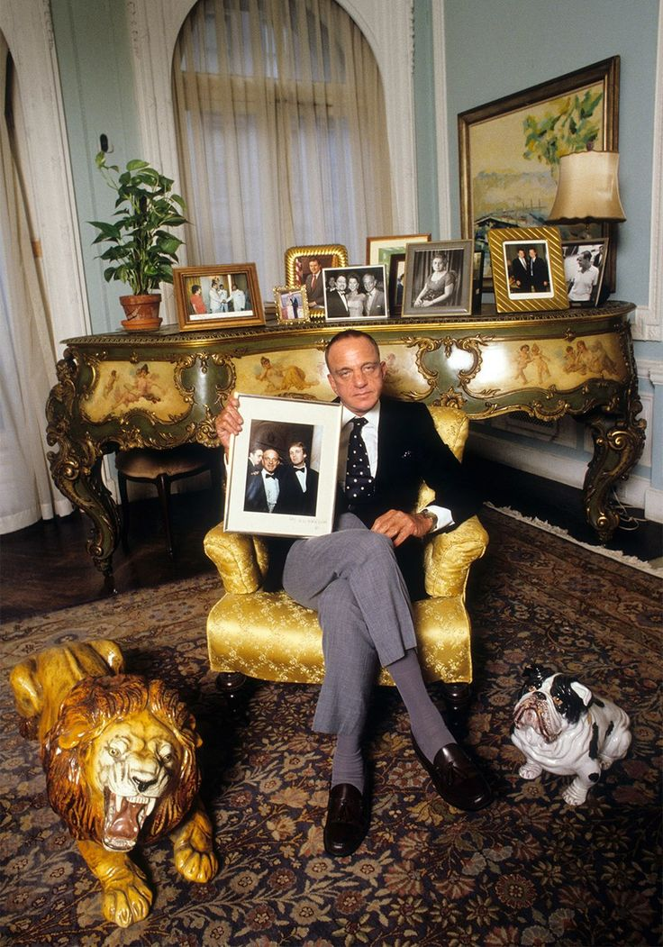 Cohn at his East 68th Street town house, with a photo of himself and Trump, 1984.